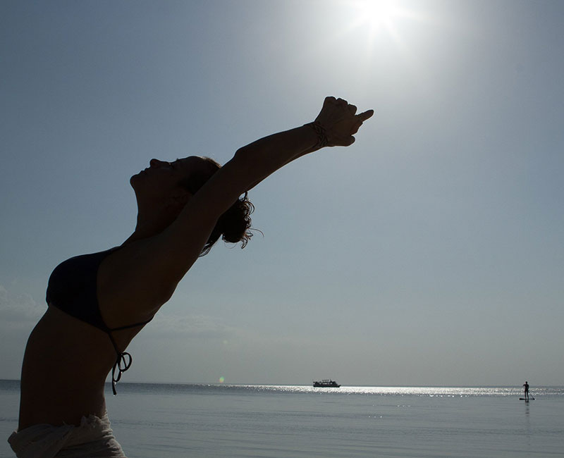 A lady doing a yoga stretch