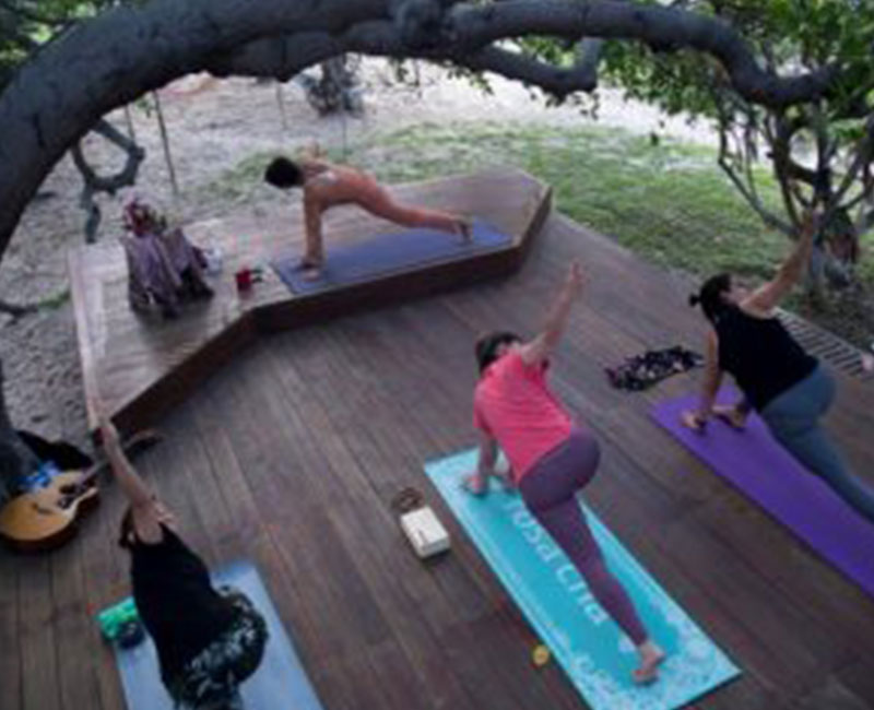 A group of people doing Yoga in Convento Arcadia, Atins