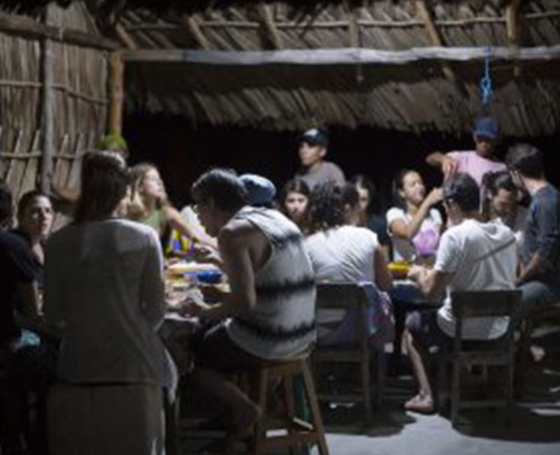 A group of people having dinner at a rest stop in Atins