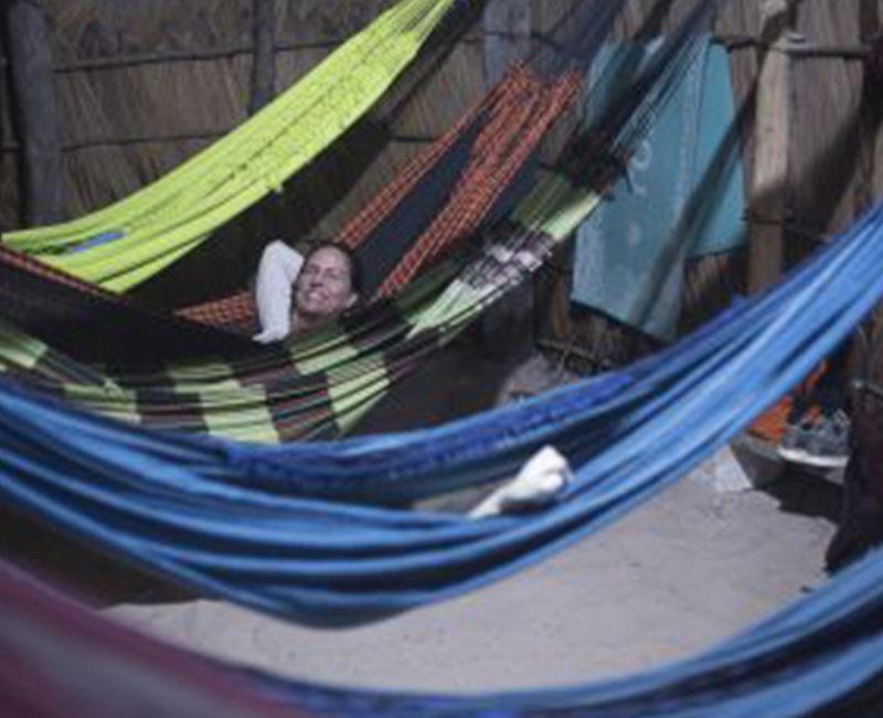 A lady resting on a hammock
