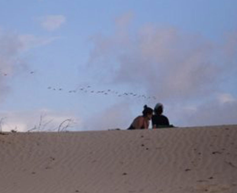A couple enjoying the sand dunes in Atins