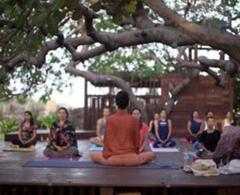 Meditating in a yoga retreat
