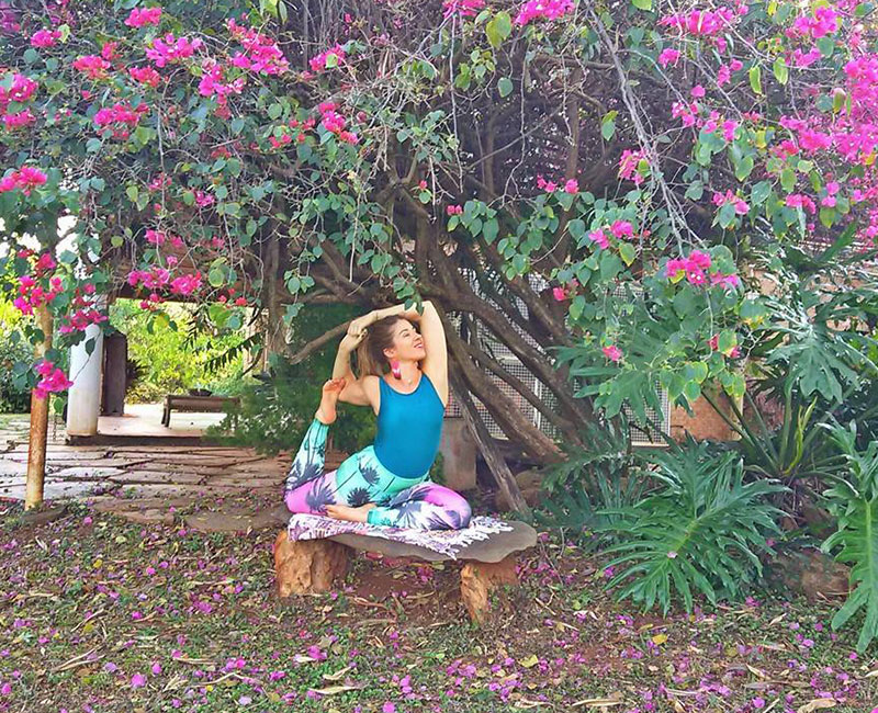 A lady doing a creative yoga pose