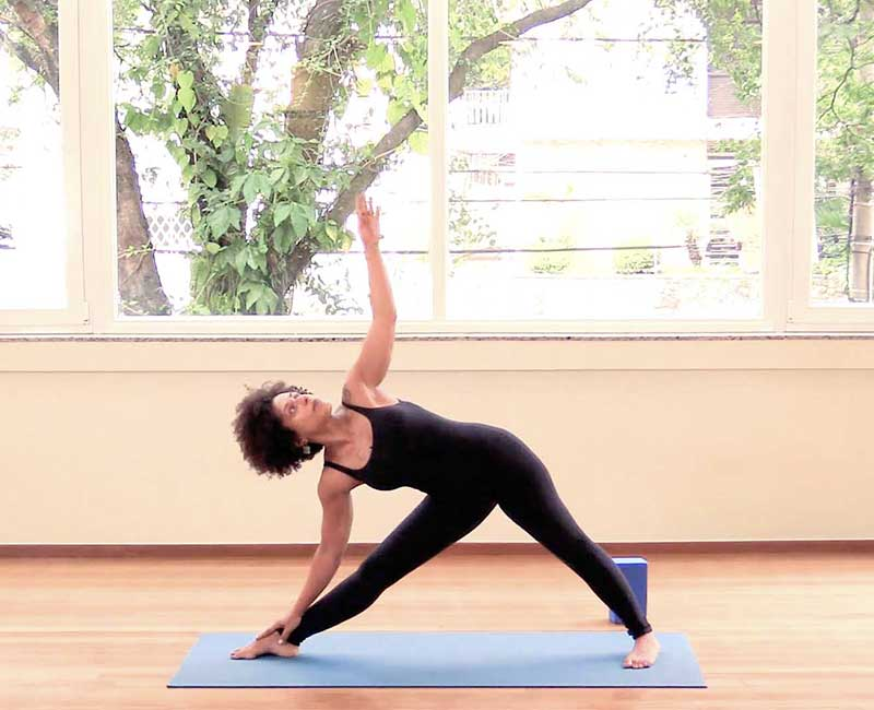 a lady doing a yoga pose