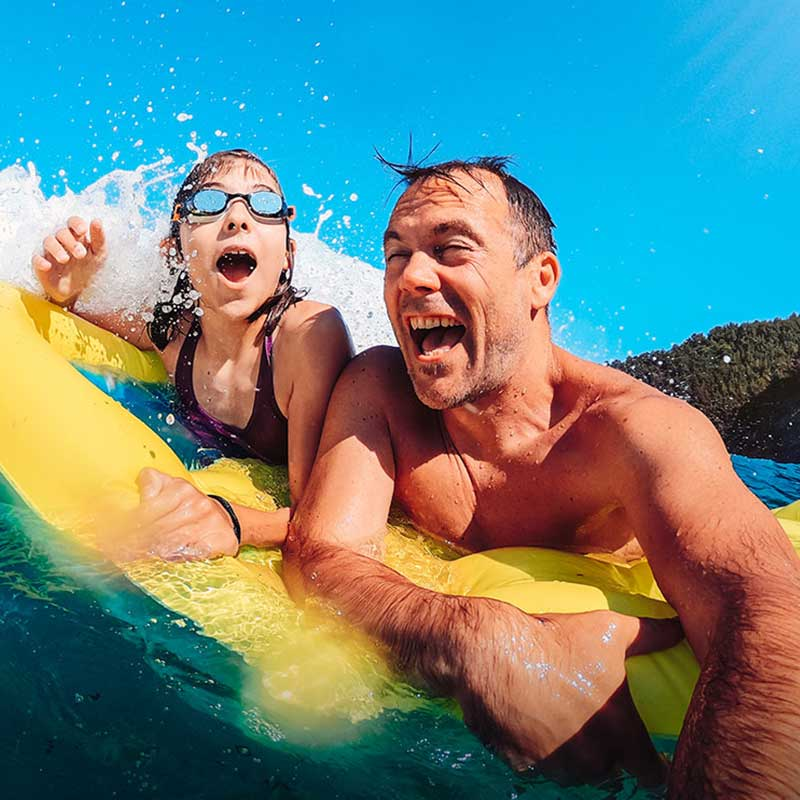 Father and kid enjoying water sports