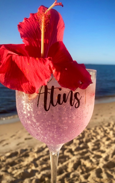 hibiscus cocktail drink by the beach