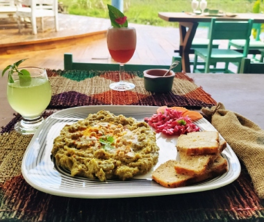 main dish with bread, salad and lime drink
