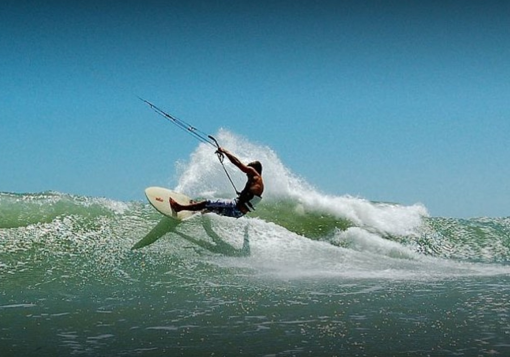 man kite surfing with good waves