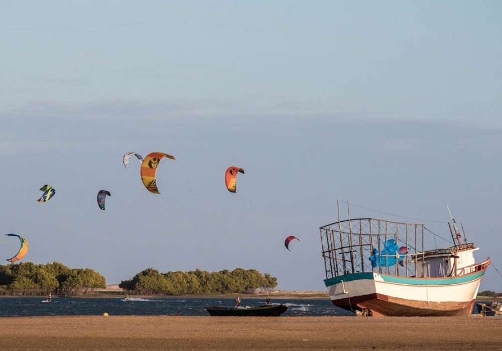 boats at the beach and kitesurfing