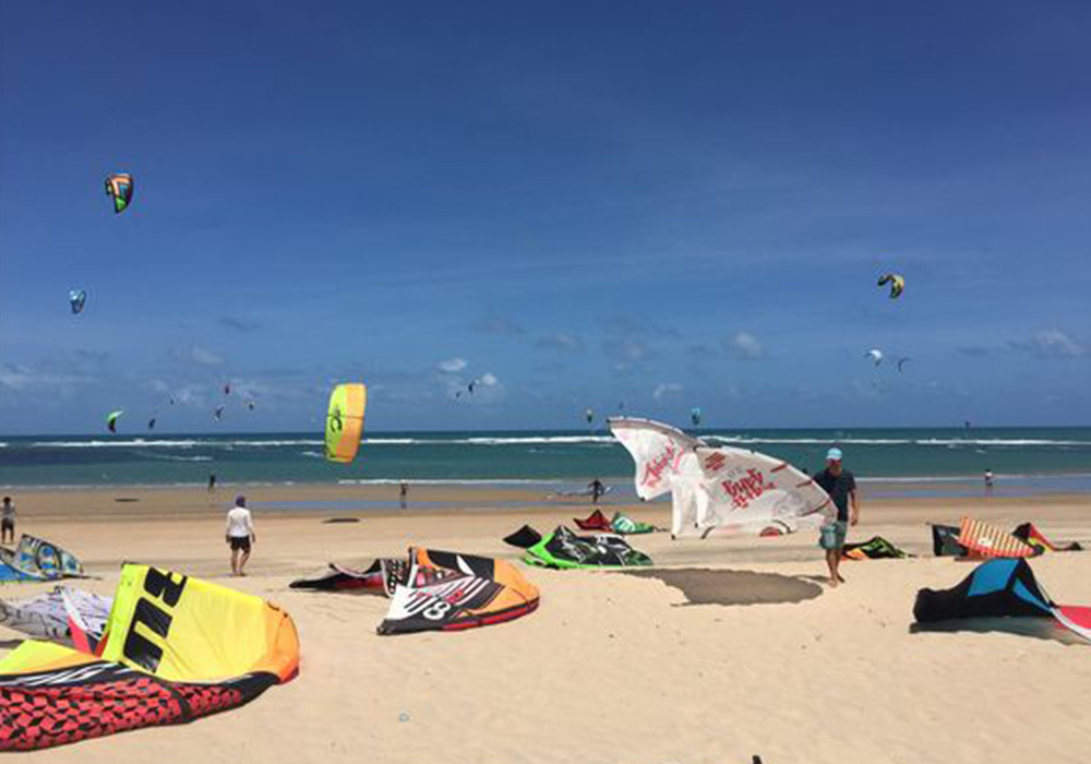 people kite surfing at beach